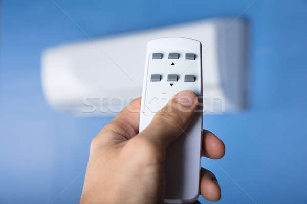 Hand Operating Air Conditioner With Remote Control Stock photo © AndreyPopov