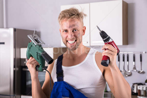 Confident Technician Holding Electric Drill And Screwdriver Stock photo © AndreyPopov