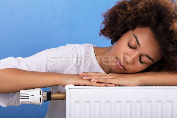 Kadın uyku ısıtma radyatör genç kadın Stok fotoğraf © AndreyPopov