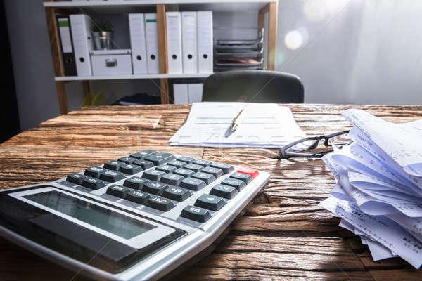 Calculadora secretária escritório Foto stock © AndreyPopov