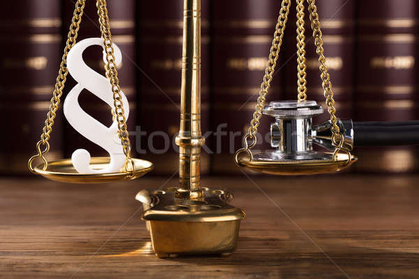 Paragraph Symbol And Stethoscope On Justice Scale Stock photo © AndreyPopov