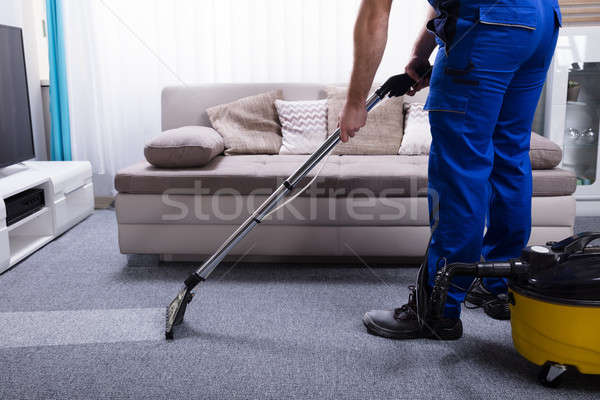 Janitor Cleaning Carpet Stock photo © AndreyPopov