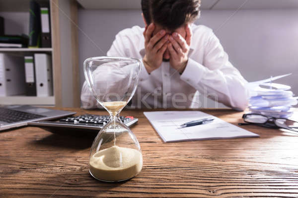 Close-up Of A Hourglass On Wooden Desk Stock photo © AndreyPopov