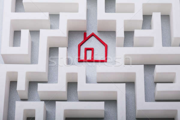 Stock photo: Red House Symbol In The Centre Of Maze