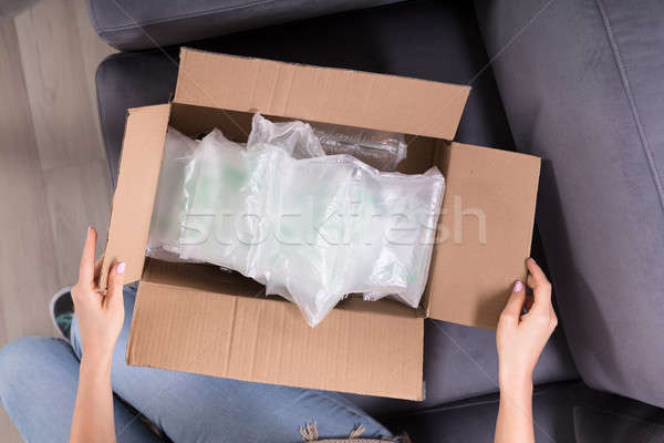 Woman Opening Delivered Parcel Stock photo © AndreyPopov