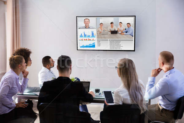 Businesspeople Video Conferencing In Boardroom Stock photo © AndreyPopov