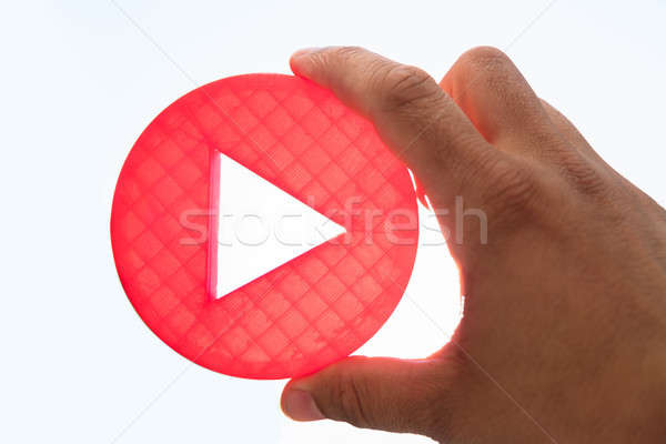 Person holding play icon Stock photo © AndreyPopov
