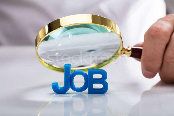üzletember tart nagyító állás szó kéz Stock fotó © AndreyPopov