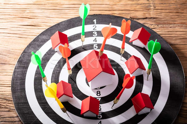 Colorful Dart Arrows Hitting House Model And Dartboard Stock photo © AndreyPopov