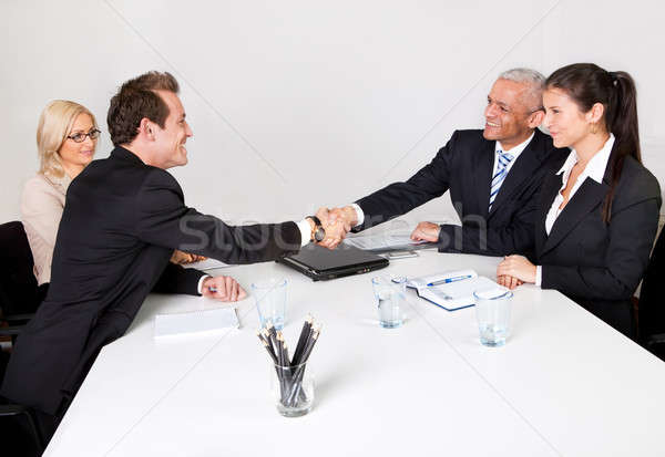 Stock photo: Business people closing the deal