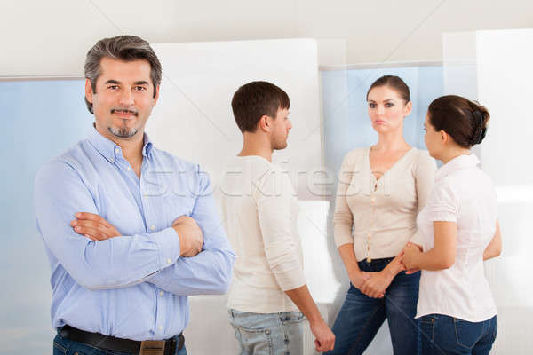 Happy Mature Man With Group Of People Stock photo © AndreyPopov
