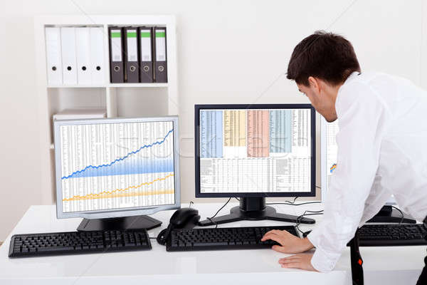 Stock broker trading in a bull market Stock photo © AndreyPopov