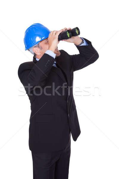 Male Architect Looking Through Binoculars Stock photo © AndreyPopov