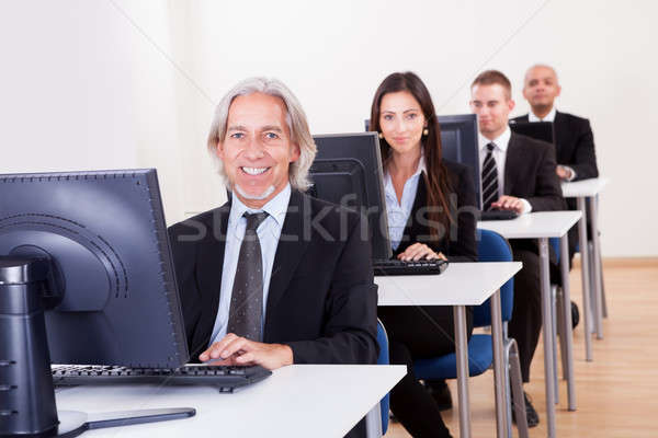 People working in a support centre Stock photo © AndreyPopov