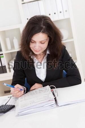 Businesswoman using a calculator Stock photo © AndreyPopov