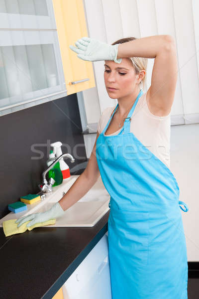 Woman Cleaning Worktop Stock photo © AndreyPopov