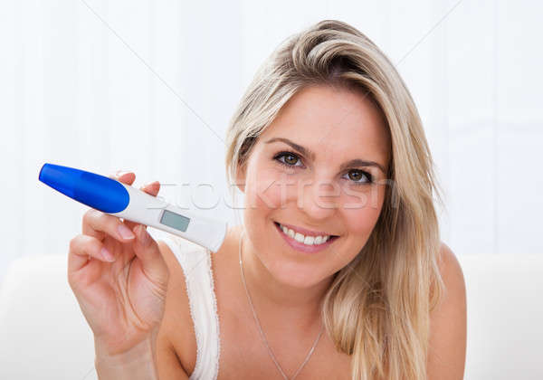 Happy woman looking  at positive pregnancy test Stock photo © AndreyPopov