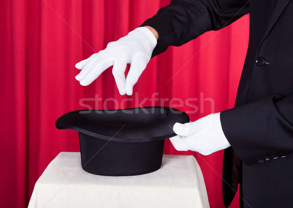 A Magician Performing Magic With Hat Stock photo © AndreyPopov