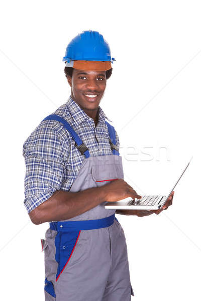 Férfi kézműves tart laptop boldog fehér Stock fotó © AndreyPopov