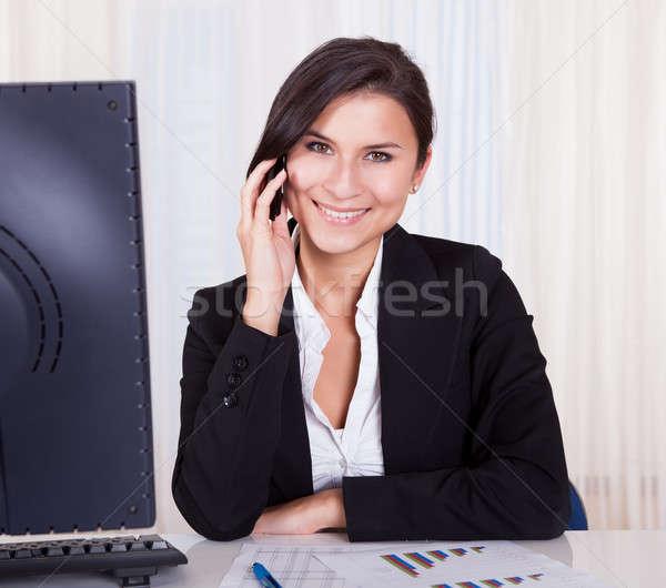 Businesswoman calling on mobile phone Stock photo © AndreyPopov