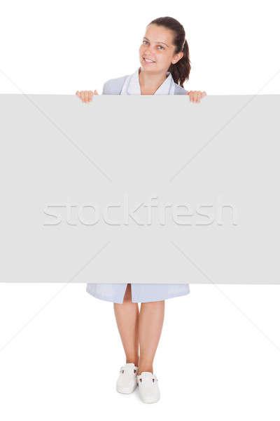 Fiatal szobalány tart plakát boldog fehér Stock fotó © AndreyPopov