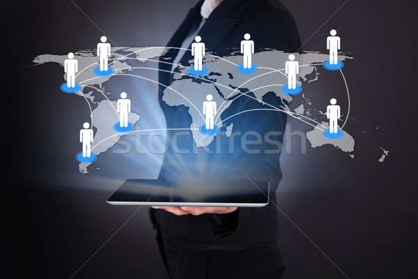 Businesswoman Holding Digital Tablet With Connected World Map Stock photo © AndreyPopov