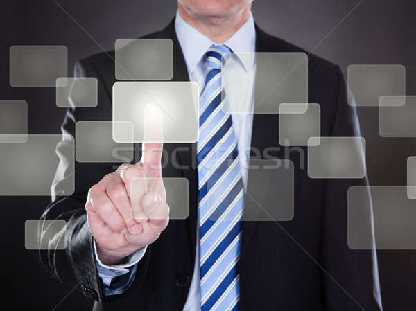 Businessman Pushing Button On Transparent Screen Stock photo © AndreyPopov