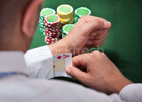 Man Pulling Ace Card From Sleeve Stock photo © AndreyPopov