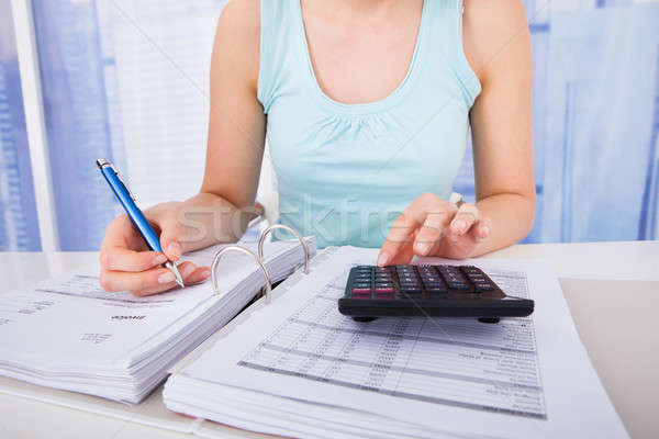 Nő otthoni pénzügyek asztal fiatal nő nők technológia Stock fotó © AndreyPopov