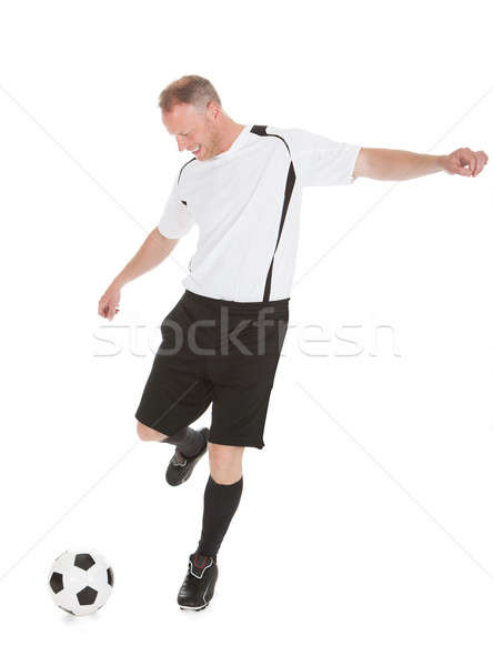 Soccer Player Kicking Football Stock photo © AndreyPopov