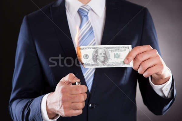 Midsection Of Businessman Burning Money Stock photo © AndreyPopov