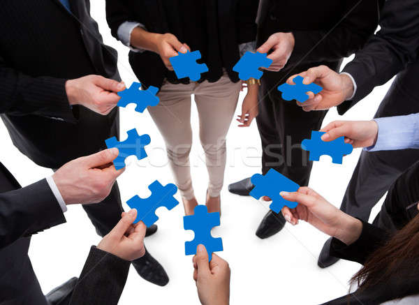 Business people connecting puzzle pieces Stock photo © AndreyPopov