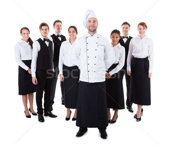 Chef permanente team geïsoleerd witte vrouw Stockfoto © AndreyPopov