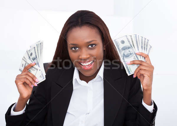 Verwonderd zakenvrouw geld fan portret Stockfoto © AndreyPopov