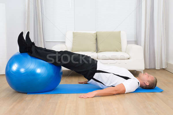 Man Exercising On A Pilates Ball Stock photo © AndreyPopov
