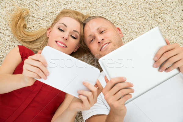 Happy Couple With Digital Tablets Stock photo © AndreyPopov