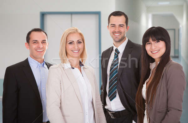 Confident Business Team Smiling In Office Stock photo © AndreyPopov
