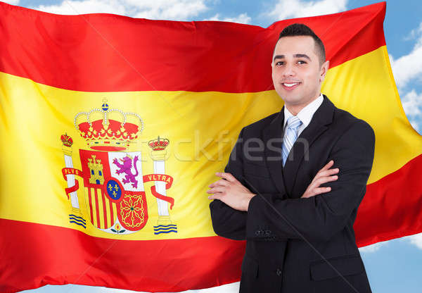 Retrato espanol empresario jóvenes pie bandera española Foto stock © AndreyPopov