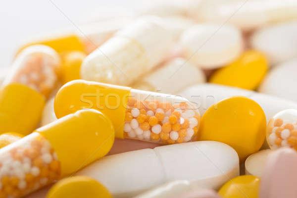 Primo piano pillole foto diverso medici medicina Foto d'archivio © AndreyPopov