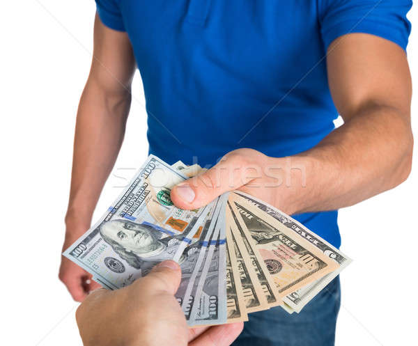 Man Holding Fanned Us Paper Currency Stock photo © AndreyPopov