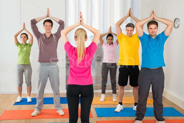 йога инструктор студентов класс женщину рук Сток-фото © AndreyPopov