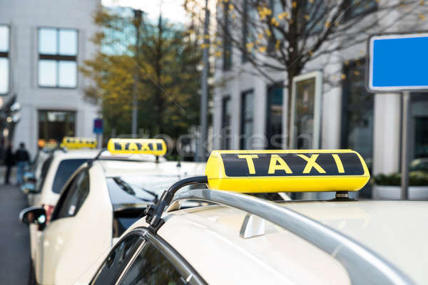 Array Of Taxi Cabs Parked Stock photo © AndreyPopov