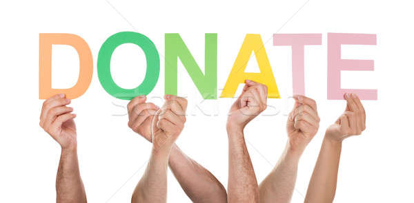 People Hands Holding Colorful Text Donate Stock photo © AndreyPopov