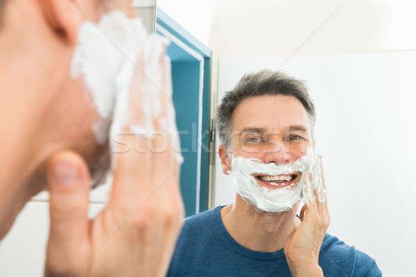 幸せ 男 適用 クリーム クローズアップ 見える ストックフォト © AndreyPopov