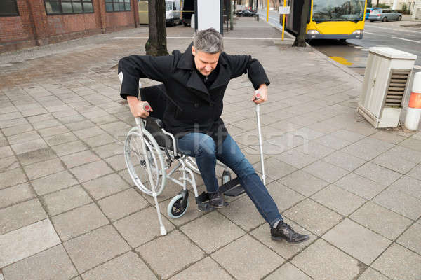 Disabled Man Trying To Walk Stock photo © AndreyPopov