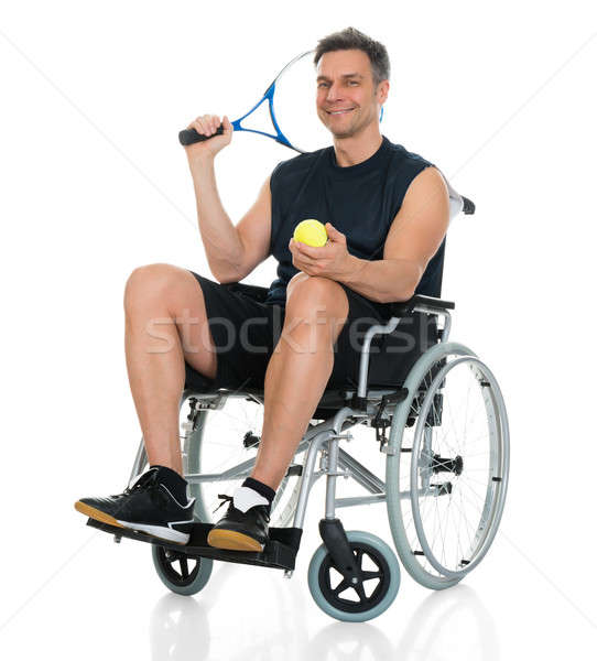 Disabled Man Holding Racket And Ball Stock photo © AndreyPopov