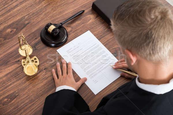 Judge Writing On Paper Stock photo © AndreyPopov