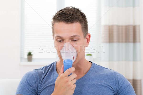 Man Inhaling Through Inhaler Mask Stock photo © AndreyPopov