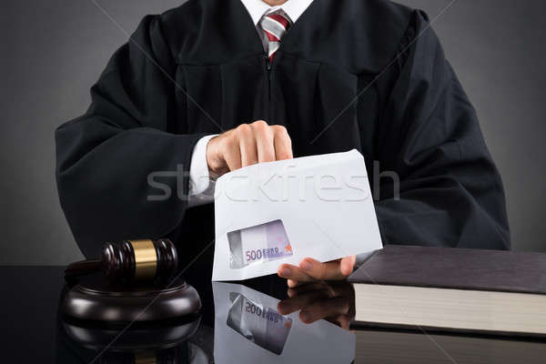 Judge Putting Money In Envelope Stock photo © AndreyPopov