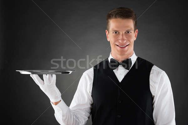 Pincér tart tálca fiatal ezüst kezek Stock fotó © AndreyPopov
